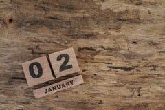 Calendário do cubo para janeiro no fundo de madeira Imagens de Stock Royalty Free