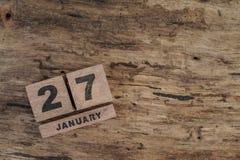 Calendário do cubo para janeiro no fundo de madeira Imagens de Stock