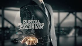 Calendário do mercado de Digitas com conceito do homem de negócios do holograma Imagens de Stock Royalty Free