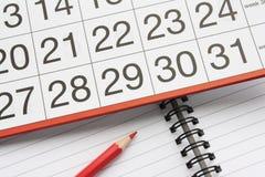 Calendário e caderno Imagens de Stock