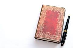 calendário e caderno do luxo 2013 com uma pena Imagem de Stock