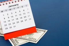 Calendário e dólar Fotografia de Stock Royalty Free