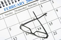Calendário e Eyeglasses Fotografia de Stock Royalty Free