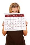 Calendário 2017: Espreitar sobre o calendário de fevereiro Foto de Stock Royalty Free