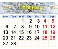 Calendário para fevereiro de 2017 com ramos nevado do pinho Fotografia de Stock Royalty Free