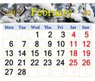 Calendário para fevereiro de 2017 com ramos nevado do pinho Foto de Stock Royalty Free