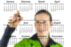Calendário virtual com uma escrita da mulher no copyspace Fotografia de Stock Royalty Free