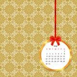 Calendar 2017 в золотой рамке круга с красным смычком на картине винтажного оформления безшовной Стоковая Фотография RF