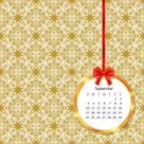 Calendar 2017 в золотой рамке круга с красным смычком на картине винтажного оформления безшовной Стоковая Фотография