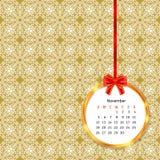 Calendar 2017 в золотой рамке круга с красным смычком на картине винтажного оформления безшовной Стоковые Изображения