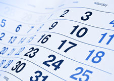 Calendar. Closeup of an generic monthly calendar with blue and black numbers Royalty Free Stock Photos