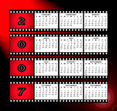 Calendar 2007 with film strip frame. A calendar for 2007 on a red graduated background with the months in a grid system over the top with film frame strip around Royalty Free Stock Photography