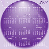 Calendar 2011 full year. January through to December months with a purple abstract background Stock Images