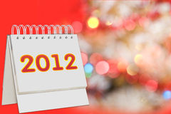 Calendar with 2012 sign over Christmas background. Calendar with 2012 sign over red Christmas background stock photos
