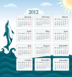 Calendar 2012 - UK version. With jumping dolphin and blue ocean. Week starts Monday, bank holidays included Royalty Free Illustration