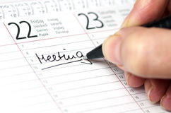 Calendar. Meeting written in a calendar Stock Photos