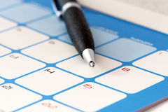 Calendar. Page and a pen royalty free stock photo