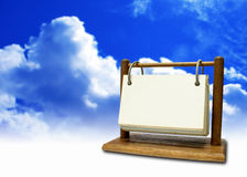 Calendar. On blue sky with clouds Royalty Free Stock Image