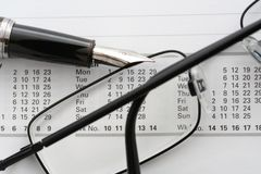 Calendar. Pen and Glasses stock photo