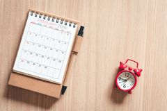 Calendar Annual With a Pen and Pocket Watch of Appointment on a Table Wooden Background. Schedule Appointment for Travel Planning. Concept stock photo