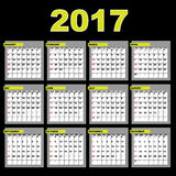 2017 calendar. A 2017 annual calendar template for your design and projects,isolated on black background. The months are divided into tables. Weeks start on Stock Photos