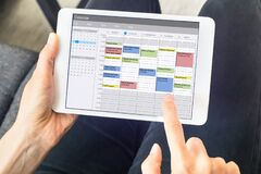 Free Calendar App On Tablet Computer With Planning Of The Week With Appointments, Events, Tasks, And Meeting. Hands Holding Device, Stock Image - 185365811