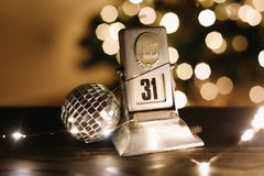 Calendar on the background of New Year`s lights and decorations. New Year Eve, December 31st Royalty Free Stock Photos