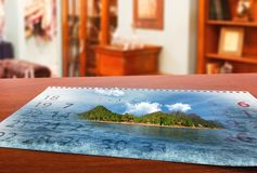 Calendar  with beautiful  landscape  on the table Stock Photography