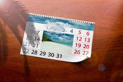 Calendar  with beautiful  landscape  on the table Royalty Free Stock Photos
