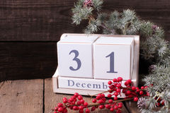 Calendar, berries and branches fur tree on aged  wooden backgrou Royalty Free Stock Photo