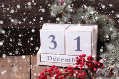 Calendar, berries and branches fur tree on aged  wooden backgrou Royalty Free Stock Photos