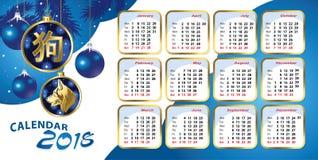 Calendar for 2018 with blue Christmas balls. Vector calendar for 2018 with blue Christmas balls and a Golden image of a dog Stock Photos