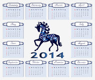 Calendar 2014 blue horse. Blue horse is the symbol of 2014 in the center of the calendar Royalty Free Stock Photo