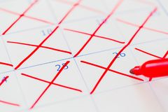 Calendar. Countdown crossing time whiteboard absence red stock photography