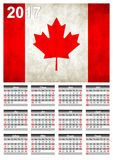 2017 Calendar - Canadian Country Flag Banner - Happy new Year. Calendar for 2017 with the Canadian flag on English language.Week starts with Sunday Stock Image