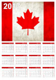 2017 Calendar - Canadian Country Flag Banner - Happy new Year. Calendar for 2017 with the Canadian flag on English language.Week starts with Sunday Stock Photography