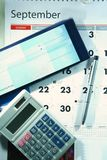 Calendar, checkbook, calculator and a ballpen. Photo of a calendar, checkbook, calculator and a ballpen Royalty Free Stock Images