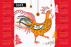 Calendar 2017 Chinese New Year of the Rooster . Vector Illustrat. Ion with xmas tree. Hand drawn silhouette colorful illustration rooster on white and red Royalty Free Stock Images