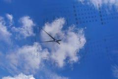 Calendar and clock on blue sky Stock Photo