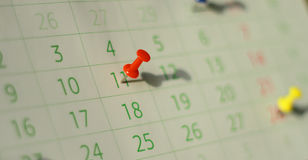 Calendar. Close up calendar page with drawing-pins. Shallow depth of field Royalty Free Stock Image