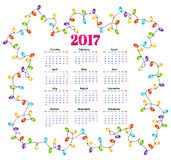 Calendar for 2017 with colorful garlands background vector.  Stock Illustration