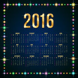 2016 calendar. Calendar for 2016 on dark blue background in a frame of multicolor glowing lights Stock Illustration
