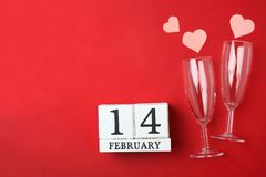 Calendar with date of February 14, two champagne glass and pink hearts royalty free stock photos