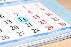 Calendar date highlighted in blue Stock Images