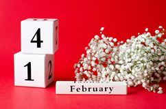 Calendar with the date Valentine`s Day and gypsophila stock photography