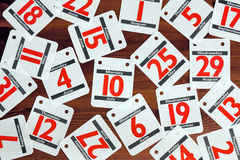 Calendar dates spread out on a wooden desk. royalty free stock photo