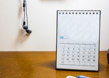 Calendar day in April 2017. On the wood desk Stock Photography
