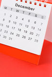 Calendar December. Close up with red background Stock Photos
