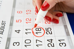 Calendar with a dedicated date on August 18. The calendar. The red marker is circled on August 18, 2017 stock image