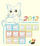 Calendar design 2012. Cat showing calendar design 2012 Royalty Free Stock Photos